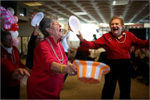 Lillian Buscanera (left) and Annette Ramsey danced at the 27th Annual Valentine's Day Party for East Boston Senior Citizens at Suffolk Downs Racetrack in East Boston on Feb. 14.