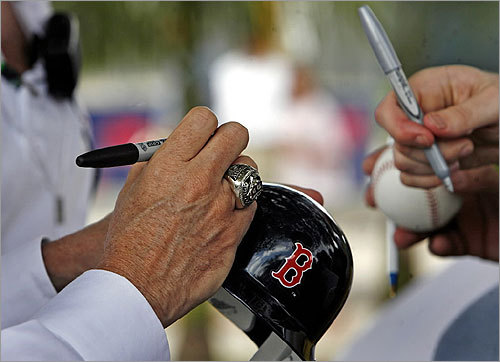 Principal owner John Henry, World Series ring prominent on his finger, signed autographs for fans.