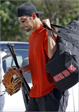 Third baseman Mike Lowell arrived Tuesday afternoon and dropped off some of his equipment.