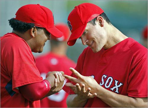 Pitchers Edgar Martinez (left) and Javier Lopez had a little fun.