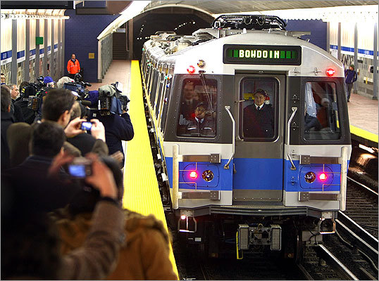 The first new Blue Line cars pulled into the Aquarium Station to pick up passengers for the inaugural trip to Bowdoin Station yesterday.