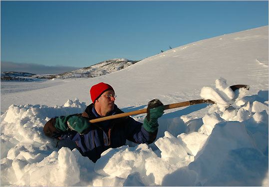 Ed English shows how to dig a snow cave in Gros Morne National Park.