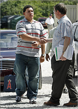 After arriving at camp shortly after noon, Bartolo Colon was greeted by Sox media relations director John Blake (right).
