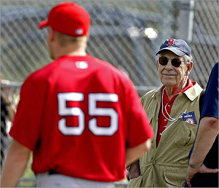 Morley Safer, of the CBS news show '60 Minutes,'' was at practice Tuesday, sporting a Red Sox cap and a press credential as he worked on a story about Sox stats guru Bill James. Safer watched outfielder Brandon Moss (55) head toward a batting cage.