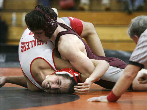 William Gilmour (left) of New Bedford wiggles his way out of a pin attempt by Lowell's James Downing at 160 pounds. Downing ended up registering a pin in the third round.