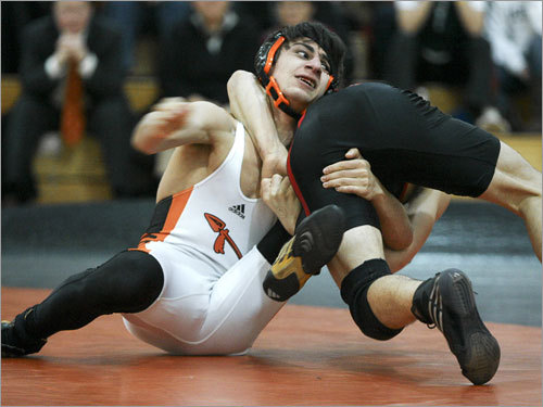 Wayland's Bryant Wolf (left) is thrown back by Winchester's Ryan Fitzpatrick at 130 pounds. Fitzpatrick won the match by decision, 3-1.
