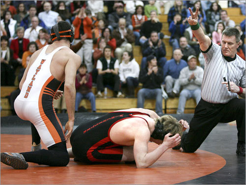 Wayland's Ross Cunningham is awarded two points during his match with Winchester's Zach Gramlich. Unfazed, Gramlich came back to register a second-round pin.