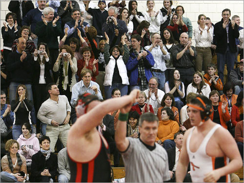 Winchester fans roar as Winchester's Andrew Zani (left) is declared the winner at 285 pounds.