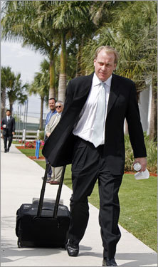 Curt Schilling headed for the bus with his luggage.