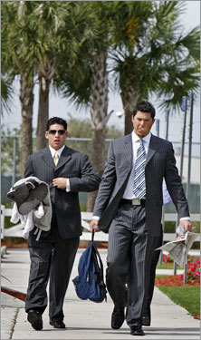 Ace Josh Beckett and center fielder Jacoby Ellsbury headed to the buses to go to the airport.