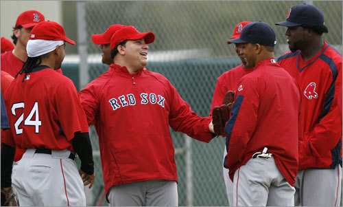 Boston Red Sox pitcher Bartolo Colon (third from left) talks with teammates (from left) Manny Ramirez, Devern Hansack, Julio Lugo, and David Ortiz before working out.