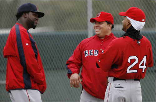 David Ortiz (left) shares a laugh with teammates Bartolo Colon (center) and Manny Ramirez during workouts.