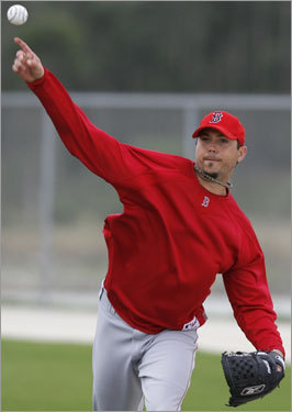 Josh Beckett fires a throw during workouts in Fort Myers.