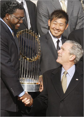 President Bush shook hands with Red Sox designated hitter David Ortiz as pitcher Daisuke Matsuzaka looked on.