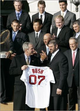 President Bush (left) was presented with an autographed jersey by Boston Red Sox catcher Jason Varitek during the ceremony honoring the 2007 World Series champions.