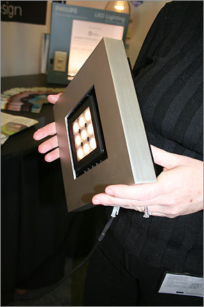 Lucy Dearborn from Lynn-based Lucia Lighting and Design shows off a new LED light from Color Kinetics. The light, which isn't yet commercially available, only uses 12 watts of energy and is 75 percent more efficient than a conventional light.