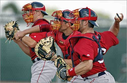 Red Sox catchers (from left) Zak Farkes, Dusty Brown, and Jason Varitek threw together during a spring training drill.