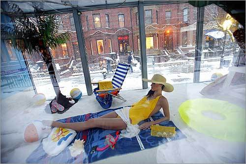 A truck outfitted with plexiglass panels on both sides advertised sunny Fort Lauderdale, Fla., as it drove down Newbury Street during a snow storm.