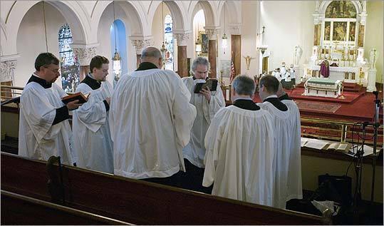 Last Sunday at Mary Immaculate of Lourdes Parish in Newton, John Salisbury (center) rehearses a men's choir before the Latin Mass.