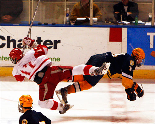 Hingham's Charlie Cifrino (17) and Xaverian's Chris Wagner (14) collide at center ice.