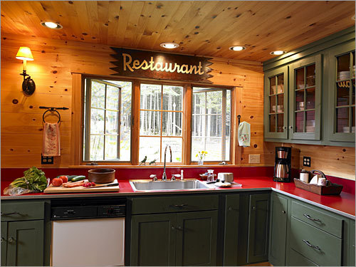 The home's modern kitchen was built in 2000 Forest green cabinets and
