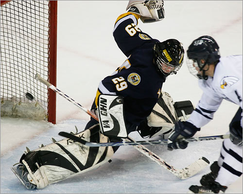 St. John's Prep winger Colin Prior lifts a goal over the pad of Xaverian netminder Kyle MacDonald.