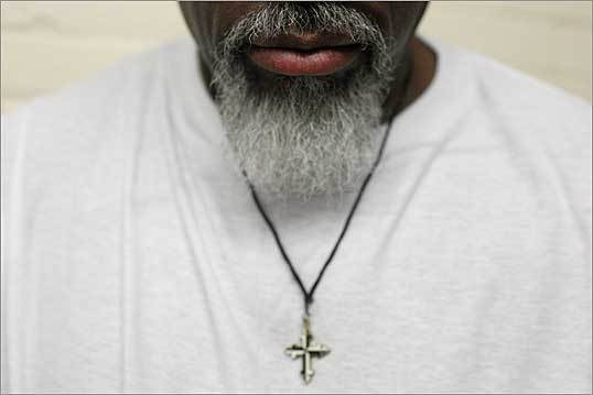 For Christians, the season of Lent is a time to reconcile with God and repent one's sins. Volunteers from Boston College have made regular visits to the state prison in Norfolk, to help inmates find a path from the past to spirituality and 'internal freedom.' Left, a prisoner during class where they study philosophy, theology and faith with volunteers from Boston College.