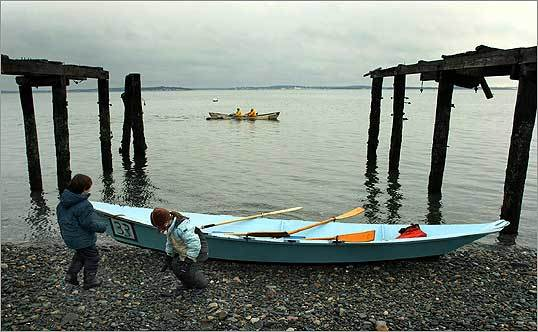During the 29th annual Snow Row hosted by the Hull Lifesaving Museum, youngsters played near a dory. The race covers a 3¾-mile triangle course starting off the beach and continuing around Sheep Island.