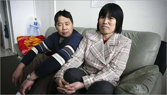 Chao Xiong Ma and his wife, Man Yi Ma, inside their East Boston apartment. The Bremen Street building in which they live was foreclosed on last year, and in January, much to the Mas' surprise, a crew of men arrived one morning to try to move them, and their belongings, out. That attempt failed, but a new one is underway. ''If we can't find housing,'' says Man Yi Ma, ''we'll have to sleep on the street.''