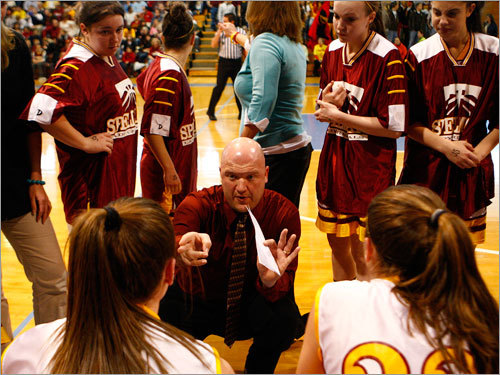 Cardinal Spellman head coach Pat Lamb talks to his players during a timeout.