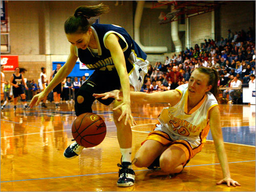 Archbishop Williams guard Courtney McNamara (20), left, battles for a loose ball with Cardinal Spellman's Catherine McManus.