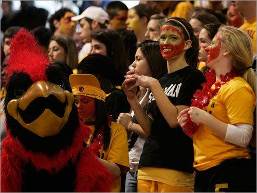 The Cardinal Spellman Cardinal and fans cheer for their team.