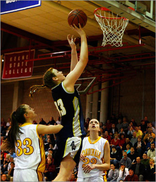 Archbishop Williams forward Valerie Driscoll (33) goes over Cardinal Spellman's Reilly Poirier (33).