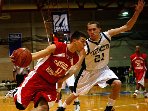 Catholic Memorial forward Julian Colarusso (11) drives on Darthmouth's Mike Toole (21).