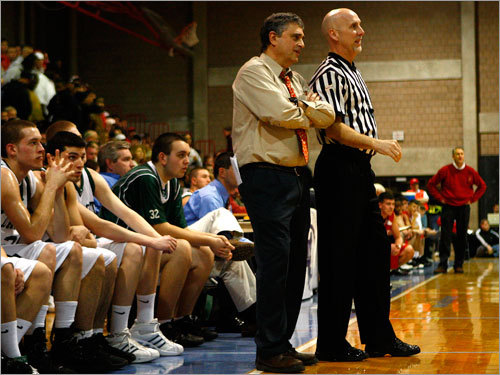 Dartmouth head coach Steve Gaspar talks over a call with a ref.