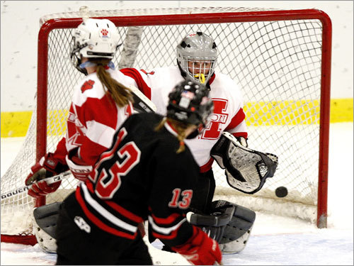 Hingham's Chrissie Bowler (13) zips a goal past Milton netminder Anna Mandell.