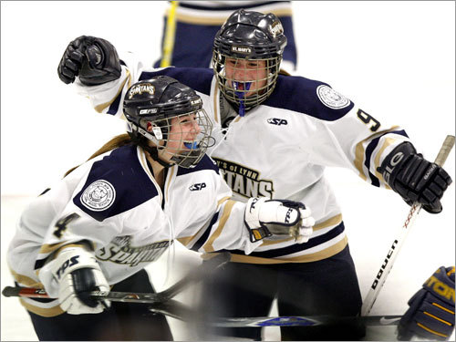 Courtney White (4) celebrates after her goal put St. Mary's on top of Wakefield, 5-1, in the second period, while teammate Erin McAndrews joins in.
