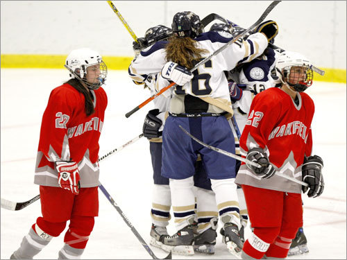 St. Mary's celebrates its fourth goal of the game en route to a 7-1 triumph over Wakefield.