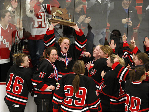 Hingham players celebrate in front of their fans.