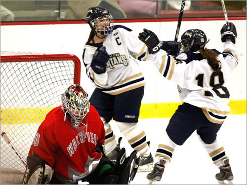 St. Mary's Abby Gauthier, and Courtney Winters (18) celebrate a second-period goal.