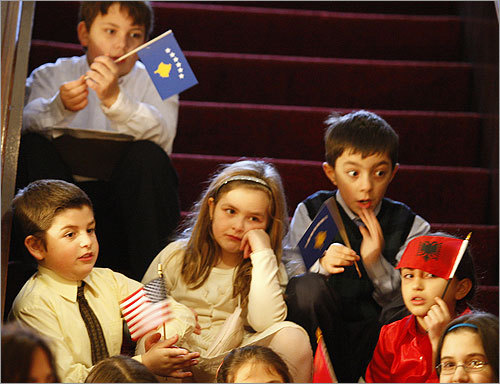 Students at the Albanian School in South Boston waited on the steps inside the St. George Cathedral during its 100th anniversary celebration. The children sang a song dedicated to teachers and mothers at the end of the service.