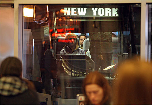 A Greyhound bus headed to New York City loaded up as passengers waited for its departure. Greyhound Lines Inc. announced it will offer a lower fare service in the future.