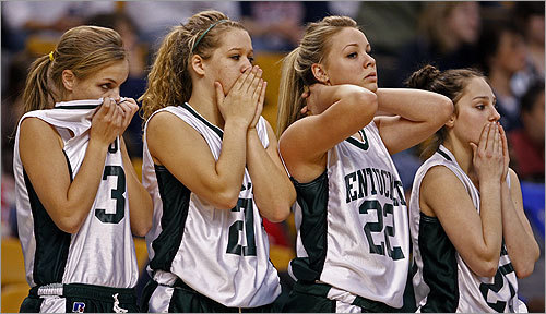 Things were going badly for the Pentucket girls basketball team. From left, Emily Lane, Hailey Brignac, Abby Gonsowski, and Holly Parker reacted to their teammate who was in pain on the court after getting injured late in the game.