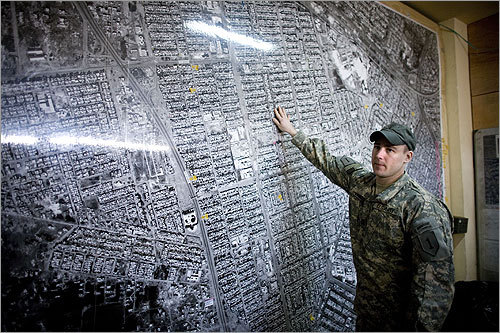 US Army Captain Sean Lyons stood before a map of the Rashid district.