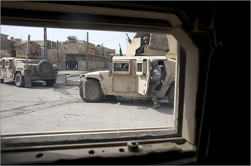 Much of Baghdad must be seen from behind the safety of armor.