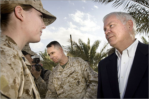 United States Secretary of Defense Robert Gates (right) visited US military base Camp Fallujah in Iraq's Anbar province. Gates greeted Marines in a brief walk and talk with the troops on his way to visit with military commanders. General Peter Pace, Chairman of the Joint Chiefs of Staff (center) accompanied the secretary of defense.