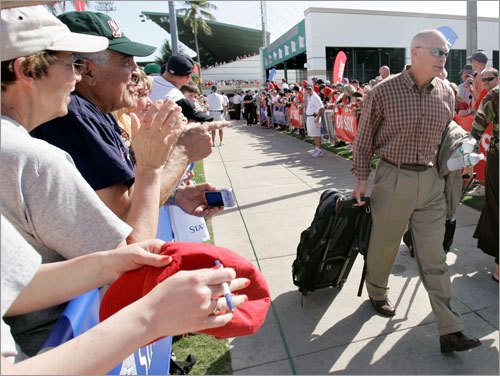 Red Sox bench coach Brad Mills departs City of Palms Park en route to Japan on Wednesday. The Red Sox ended a threatened boycott of their final spring training game in Florida, resolving a dispute over paying coaches for the season-opening trip to Japan. The game against Toronto started an hour late when the team voted unanimously not to play or go to Tokyo after learning coaches and staff would not get a $40,000 appearance fee for the Japan trip.