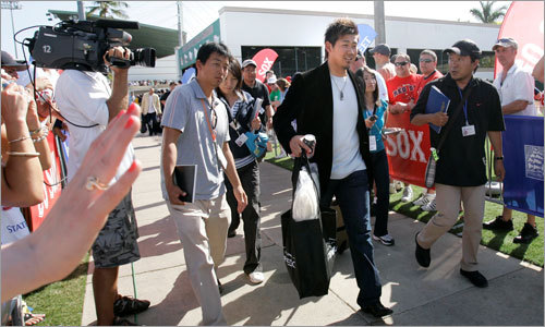 Red Sox pitcher Daisuke Matsuzaka departs City of Palms Park en route to Japan on Wednesday.