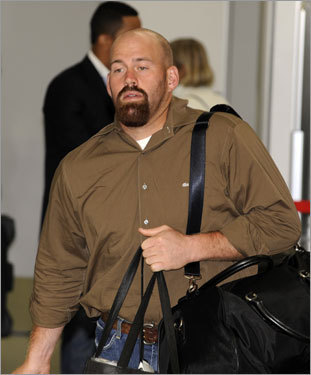 Kevin Youkilis carries his luggage through the Tokyo airport after 18 hours of flying.