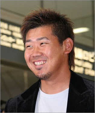 Game 1 starter and Japan native Daisuke Matsuzaka has a smile across his face after arriving in Tokyo. The Sox arrived after midnight Tokyo time (around 11 a.m. Eastern).